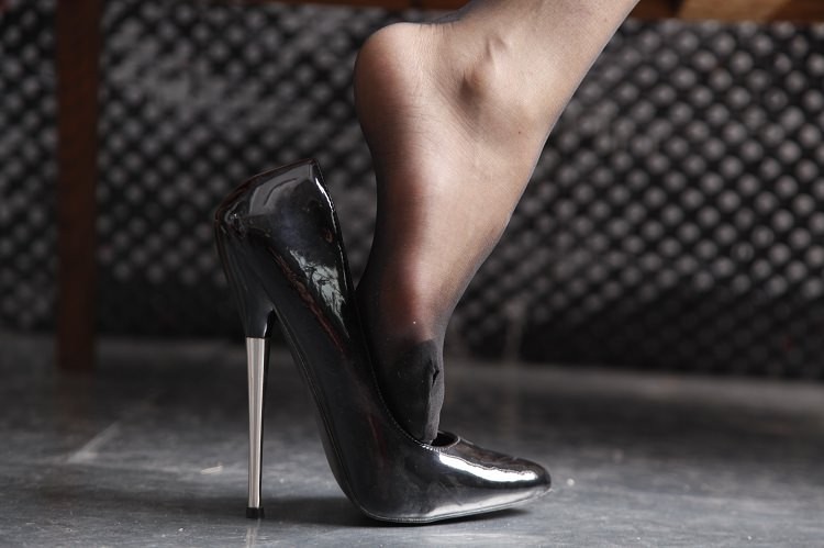 foot-coming-out-of-meta-heel-shoe